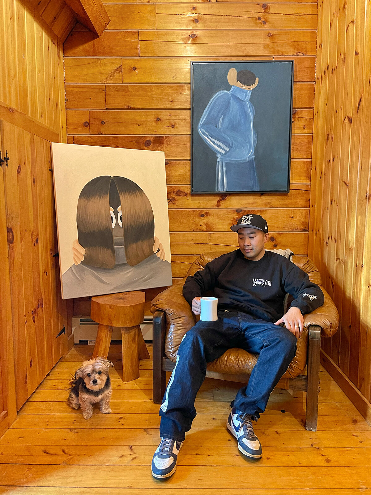 Portrait of Jason Lee  with works, from left to right, by Willem Hoeffnagel and Julia De Ruvo, 2021. Courtesy of Jason Lee.