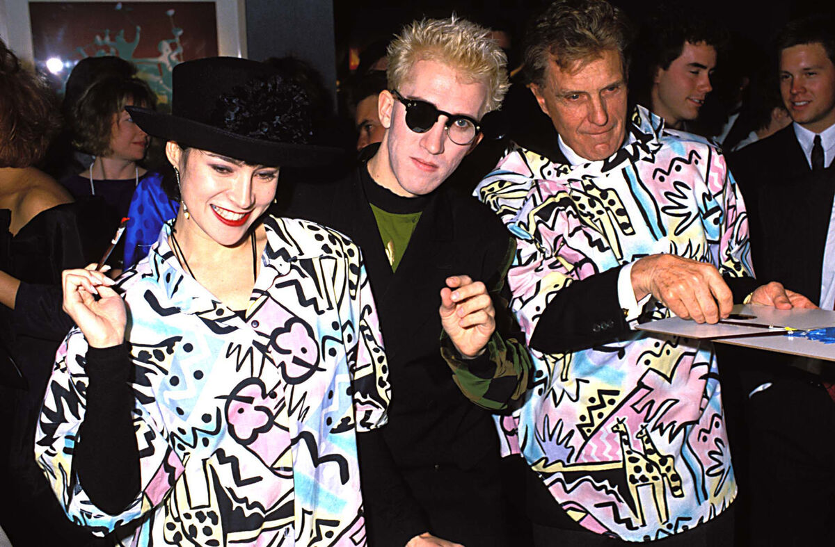Jennifer Tilly, Mark Kostabi and Robert Stack during a party for Kostabi in Beverly Hills, California, United States, 1988. Photo by Jeff Kravitz/FilmMagic, Inc.