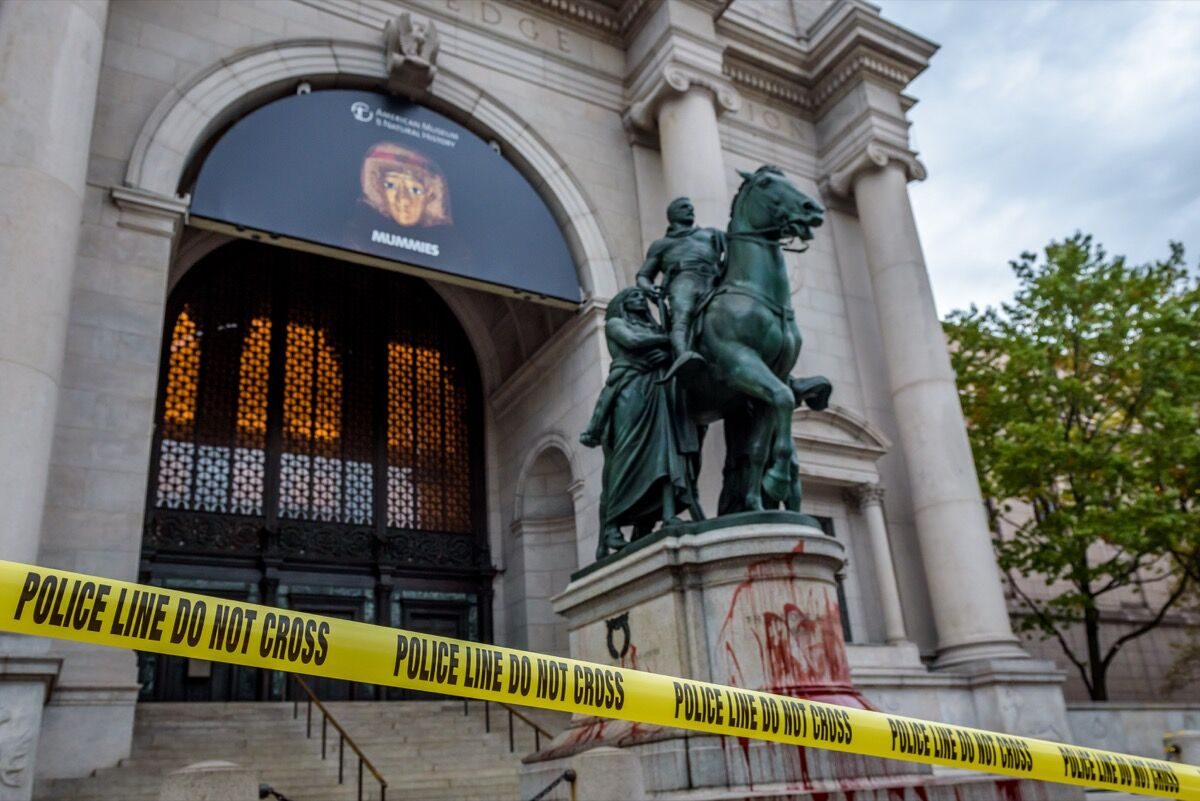 The statue of Theodore Roosevelt outside the American Museum of Natural History in New York was covered with a blood-like substance by activists demanding its removal on October 26, 2017. Photo by Erik McGregor/LightRocket. Image via Getty Images.