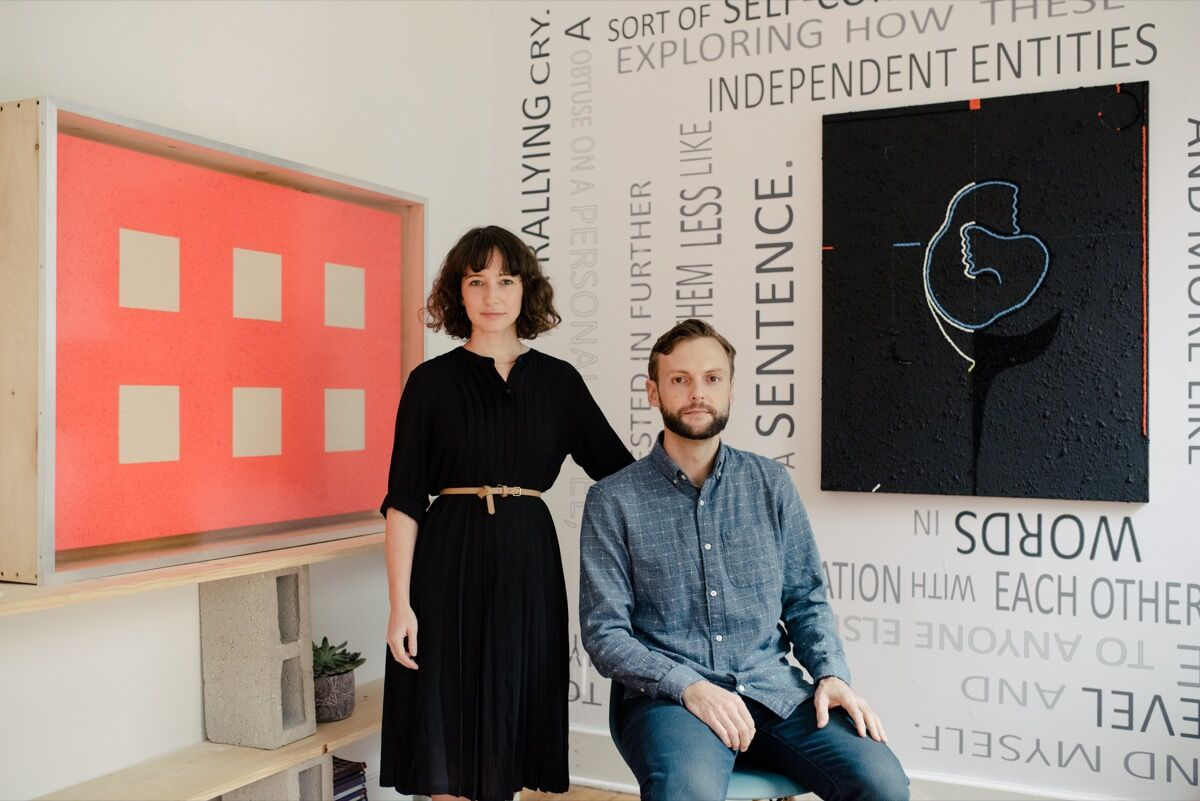 Ariela Gittlen and Scott Indrisek of Teen Party in their apartment with artworks by Peter Halley and Tracy Thomason. Photo by Daniel Dorsa for Artsy.