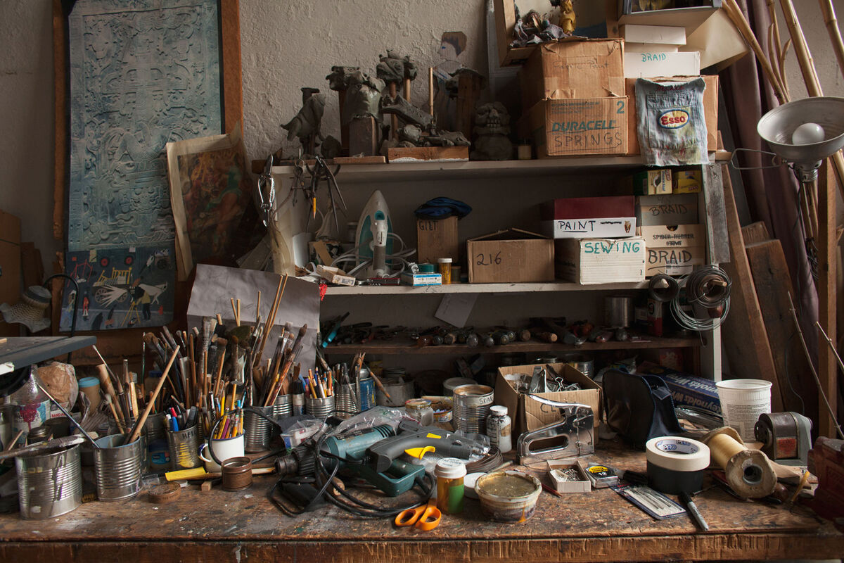 The work table in Ralph Lee's home studio is the origin of many of the puppets featured in the Greenwich Village Halloween Parade. The beloved annual event has attracted over 2 million spectators since Lee founded it at Westbeth in 1974. Photo by Frankie Alduino.