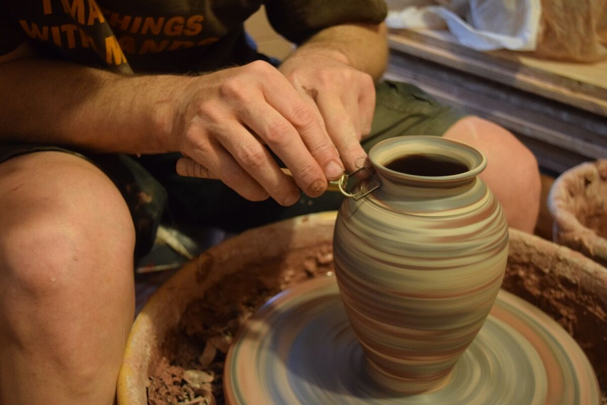 Eck McCanless at the pottery wheel. Photo by Richard Shoenberger.