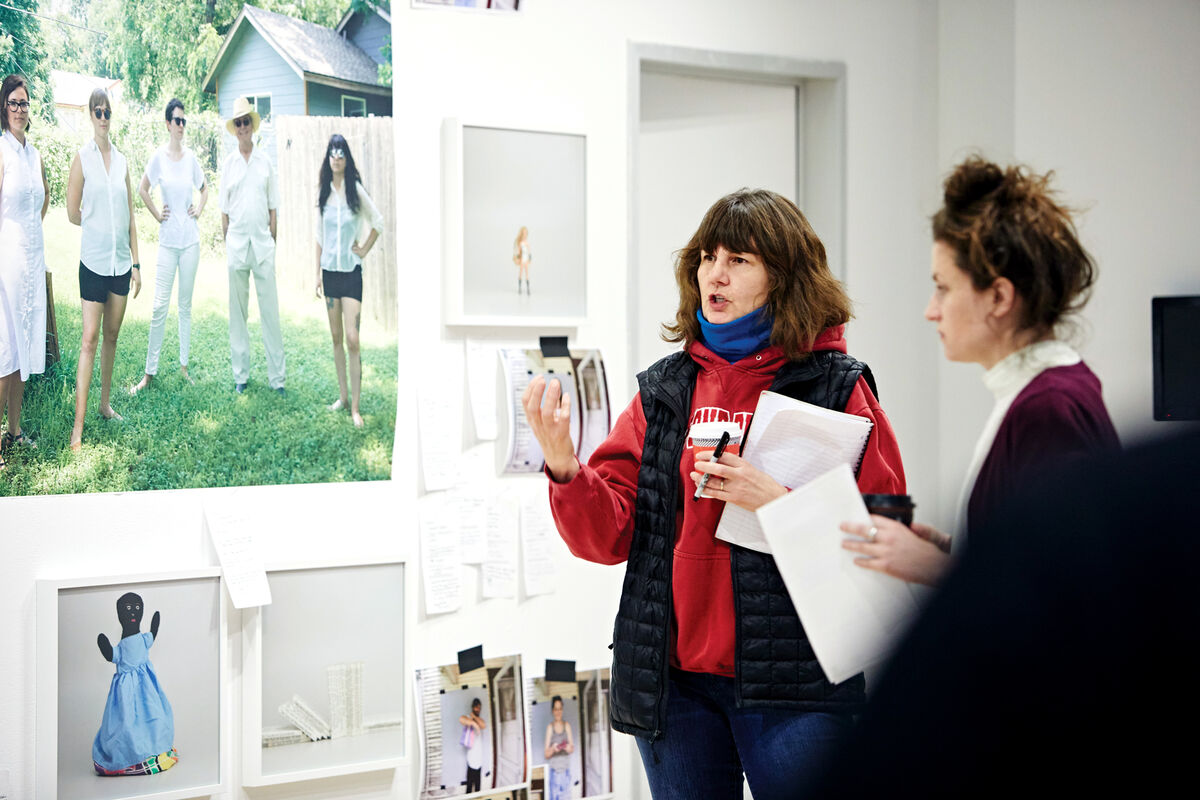 Artist Michelle Grabner speaking to a student at the School of the Art Institute of Chicago. Courtesy the School of the Art Institute of Chicago.