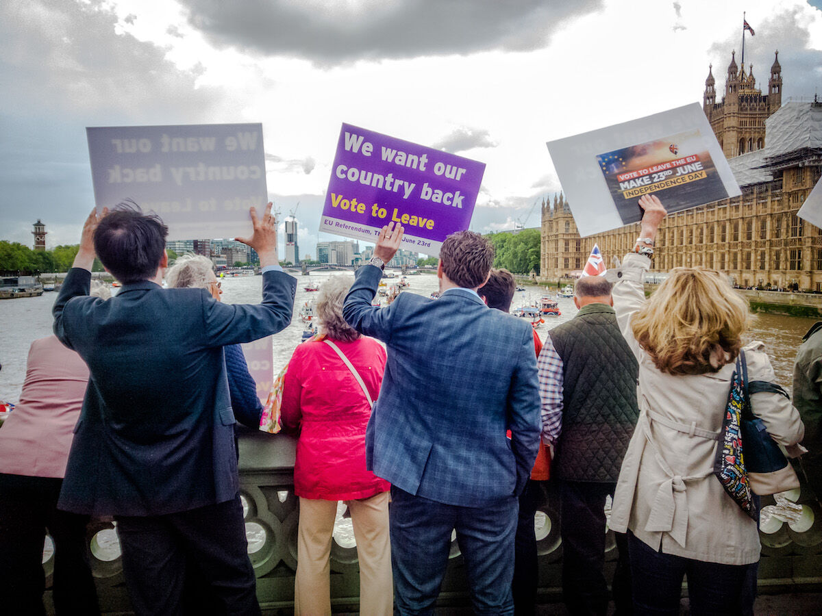 Pro-Brexit demonstrators rally near the Houses of Parliament in London in June 2016. Photo by Garry Knight, via Wikimedia Commons.