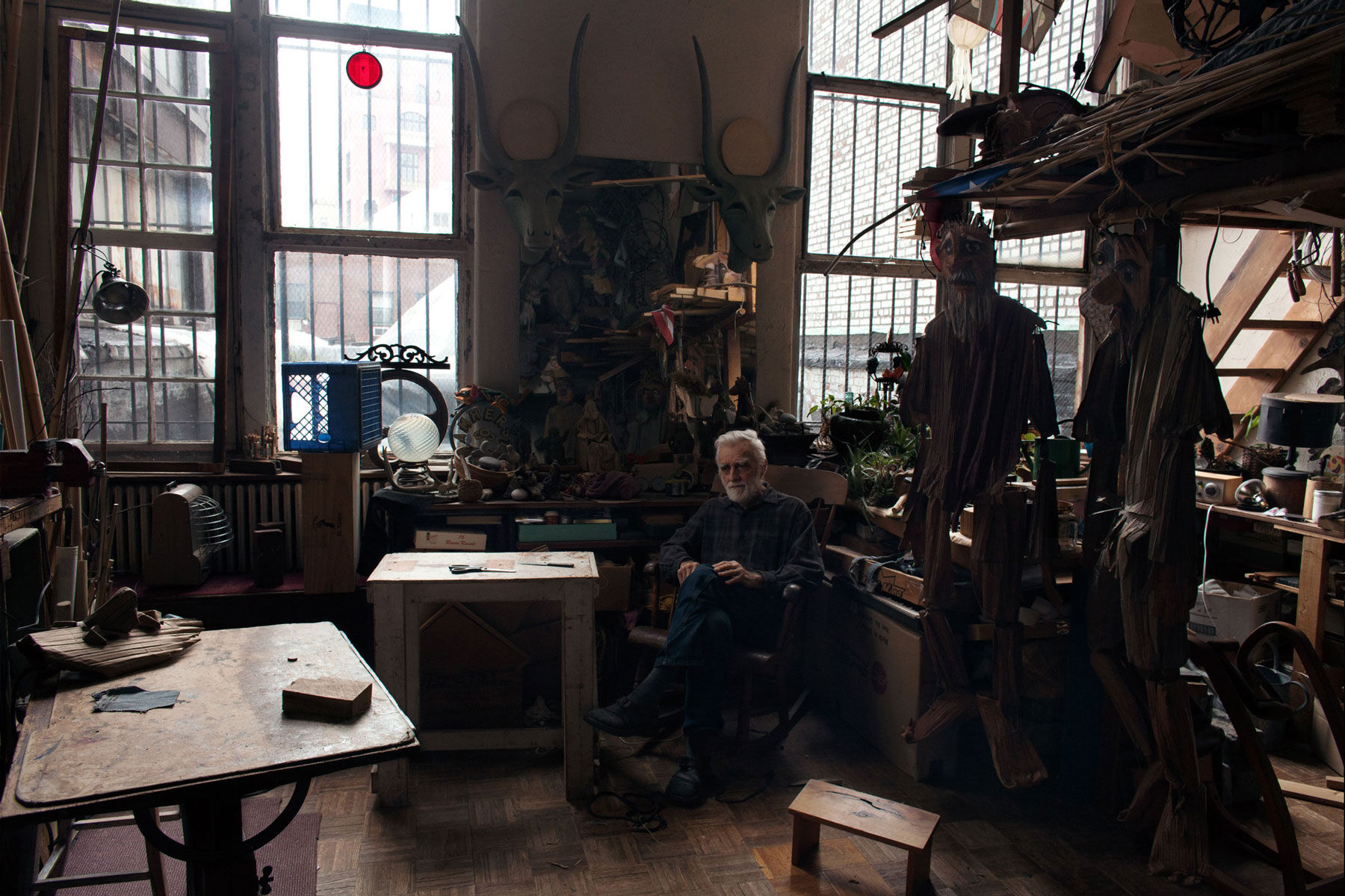Theater artist Ralph Lee, 83, loves spending time in his studio located in the apartment he moved into with his wife and three children in 1970. He curates a rotating array of his fantastical puppets in an unused guard booth in the Westbeth courtyard. Photo by Frankie Alduino.