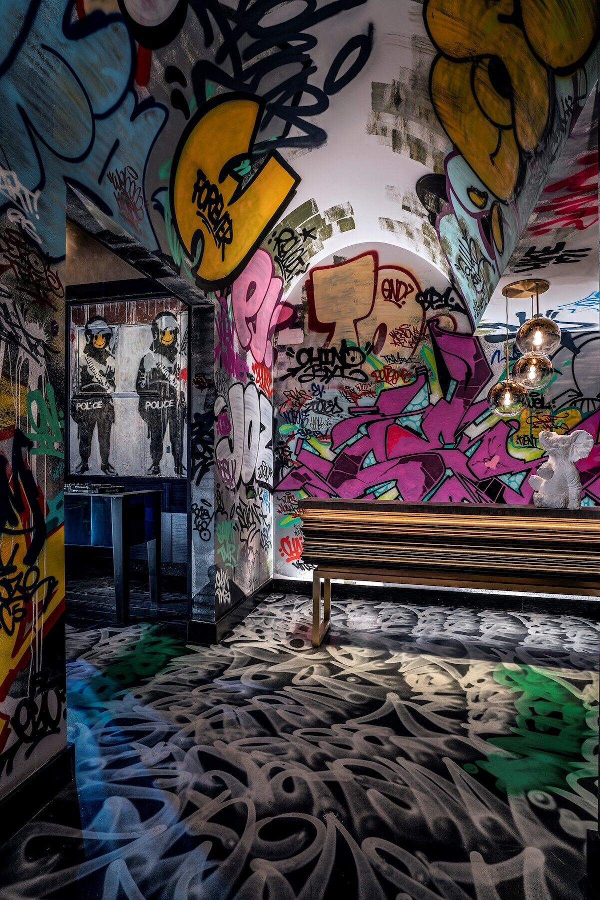 Banksy, Smiley Coppers Panel I, 2002, on view in the Green St. Kitchen at the Palms Casino Resort. Photo by Clint Jenkins.