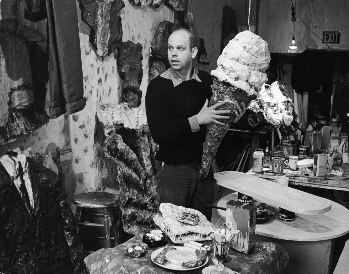 Swedish-born American artist Claes Oldenburg holds one of his pieces, a four-foot ice cream cone, at his studio on the Lower East Side, New York City, circa 1965. Photo by Archive Photos/Getty Images.