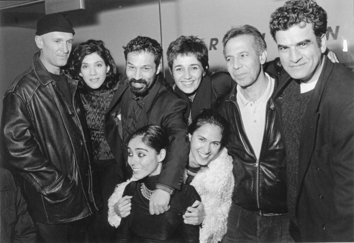 """Shirin Neshat (center, left) at the opening of her exhibition """"Turbulent"""" at the Whitney Museum in 1998."""