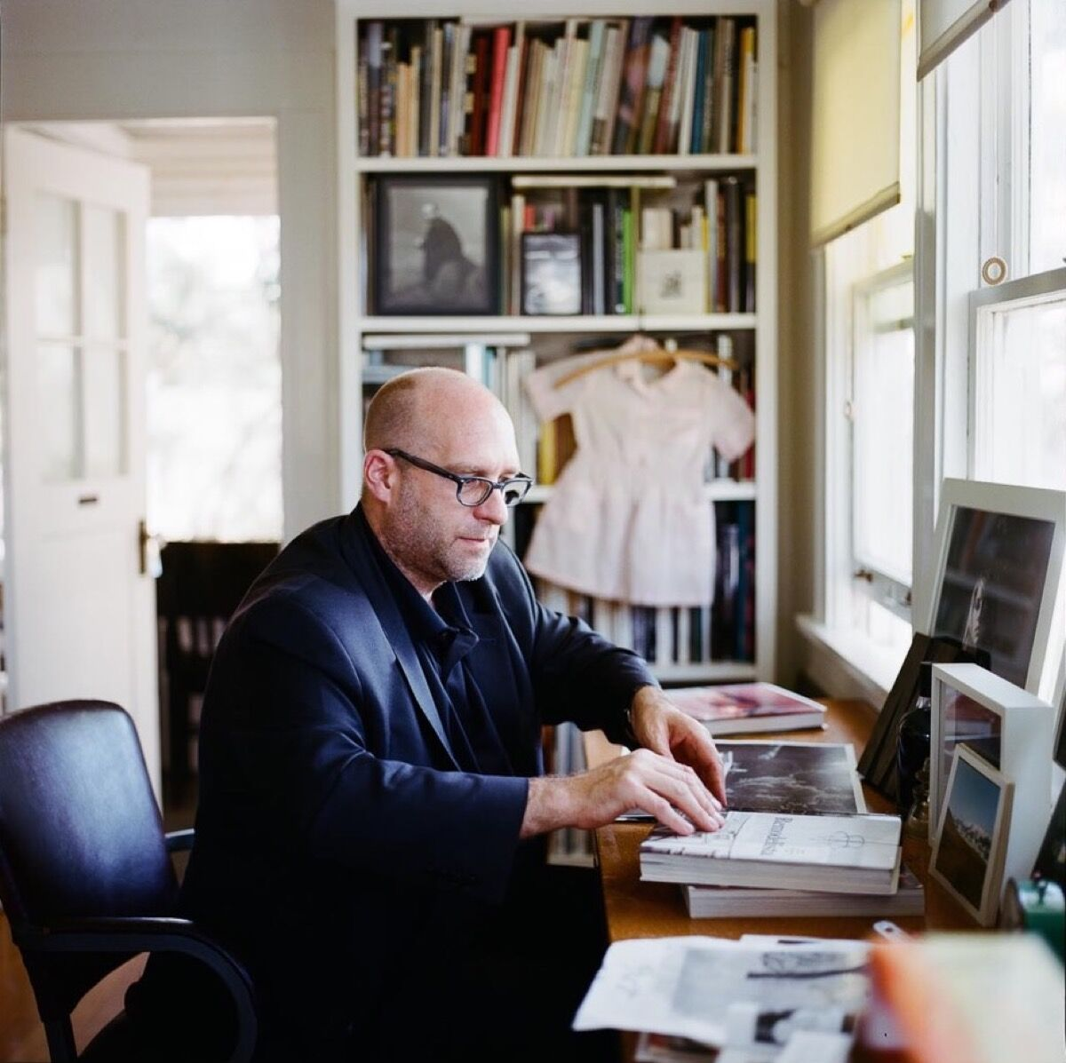 Todd Hido with his photo book collection. © Todd Hido.