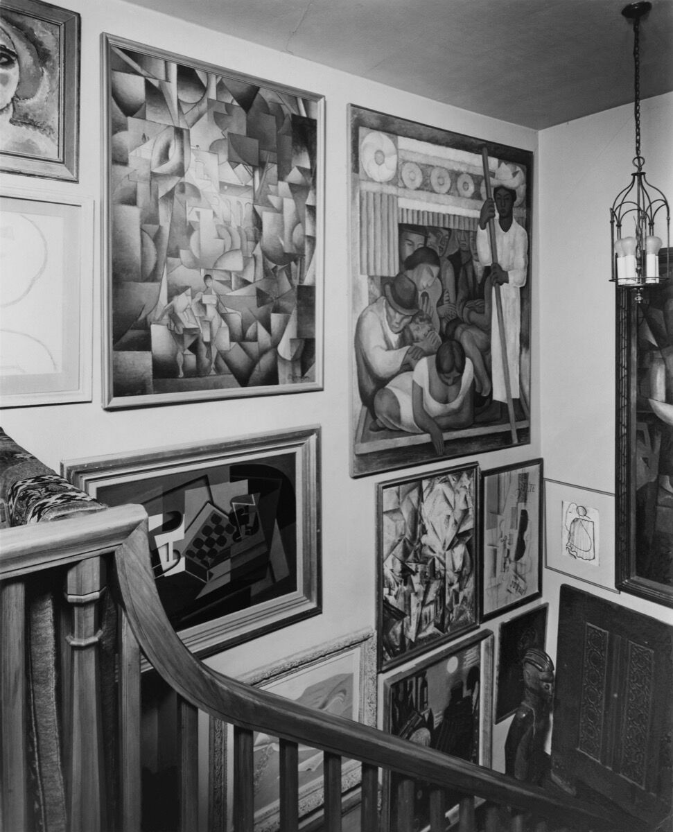 Second Floor, ca.1944 (no later than January 1949). Courtesy of Philadelphia Museum of Art, Library and Archives, Arensberg Archives. Pictured artworks: Georges Braque, Violin and Newspaper, 1912–13. © 2020 Artists Rights Society (ARS), New York / ADAGP, Paris; Max Ernst, Garden Plane Trap, 1934–35. © 2020 Artists Rights Society (ARS), New York / ADAGP, Paris; Lyonel Feininger, Umpferstedt II, 1914. © 2020 Artists Rights Society (ARS), New York / VG Bild-Kunst, Bonn; Carlos Mérida, The Window, 1933. © 2020 Artists Rights Society (ARS), New York / SOMAAP, Mexico City; Jean Metzinger, The Bathers, 1913. © 2020 Artists Rights Society (ARS), New York / ADAGP, Paris; Diego Rivera, The Flowered Canoe, 1931. © 2020 Banco de México Diego Rivera Frida Kahlo Museums Trust, Mexico, D.F. / Artists Rights Society (ARS), New York.
