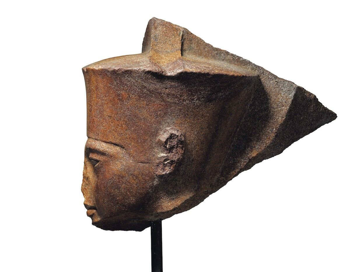 An Egyptian brown quartzite head of the god Amen with the features of pharaoh King Tutankhamen, New Kingdom, 18th Dynasty, reign of Tutankhamun, ca. 1333–1323 B.C.E. Courtesy Christie's.
