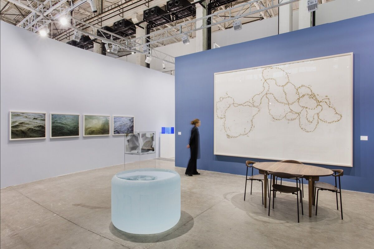 Installation view of Hauser & Wirth's booth at West Bund Art & Design Fair, 2018, with works by Larry Bell, Eduardo Chilida, and Roni Horn. Photo by JJPhoto. Courtesy of Hauser & Wirth.