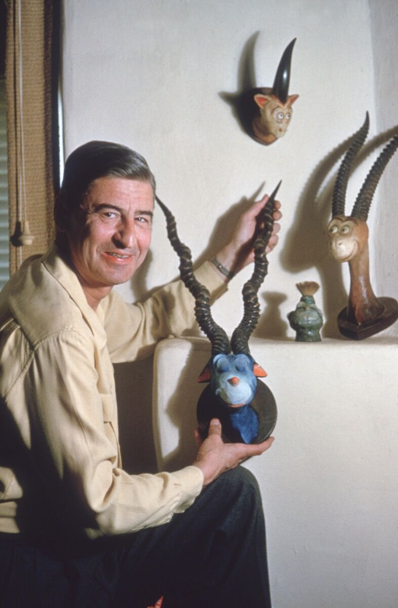 b50d007d Theodor Seuss Geisel holds the head of one of his characters, April 25, 1957
