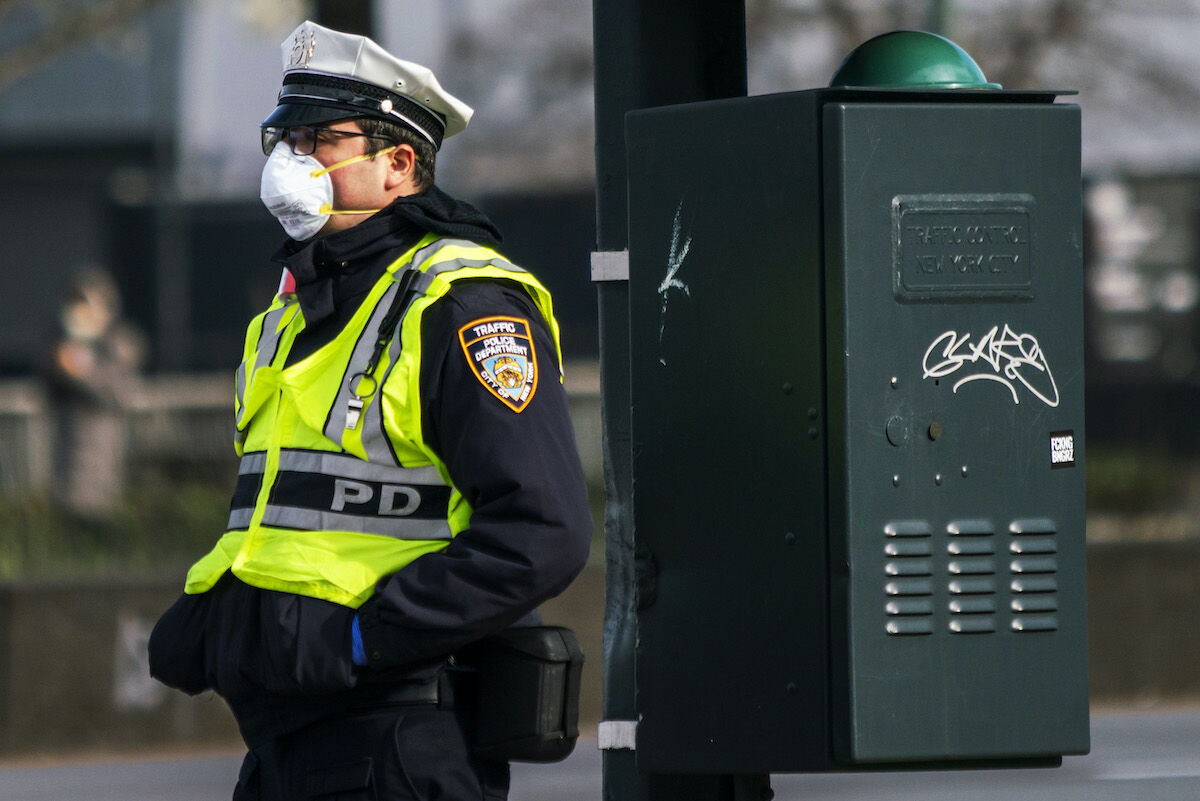 An NYPD officer wearing a face mask. Photo by Eduardo Munoz Alvarez via Getty Images