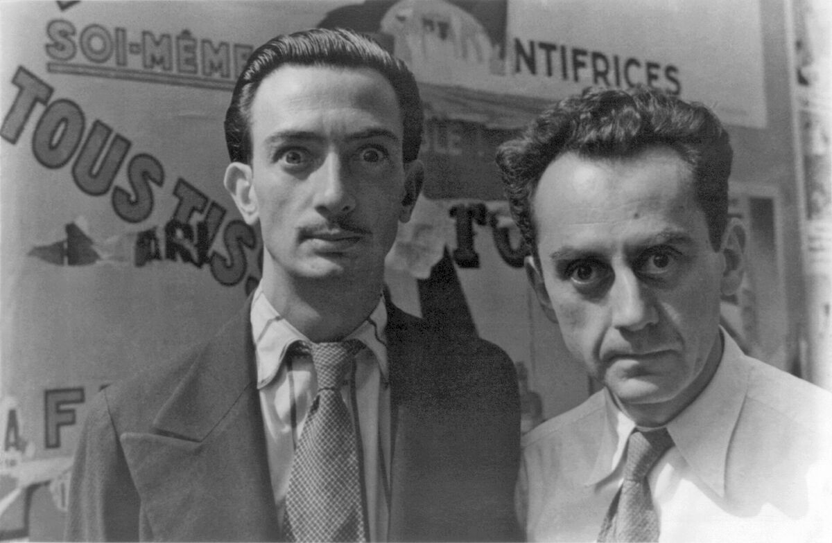 Portrait of Salvador Dalí and Man Ray in Paris, by Carl Van Vechten, via Wikimedia Commons.