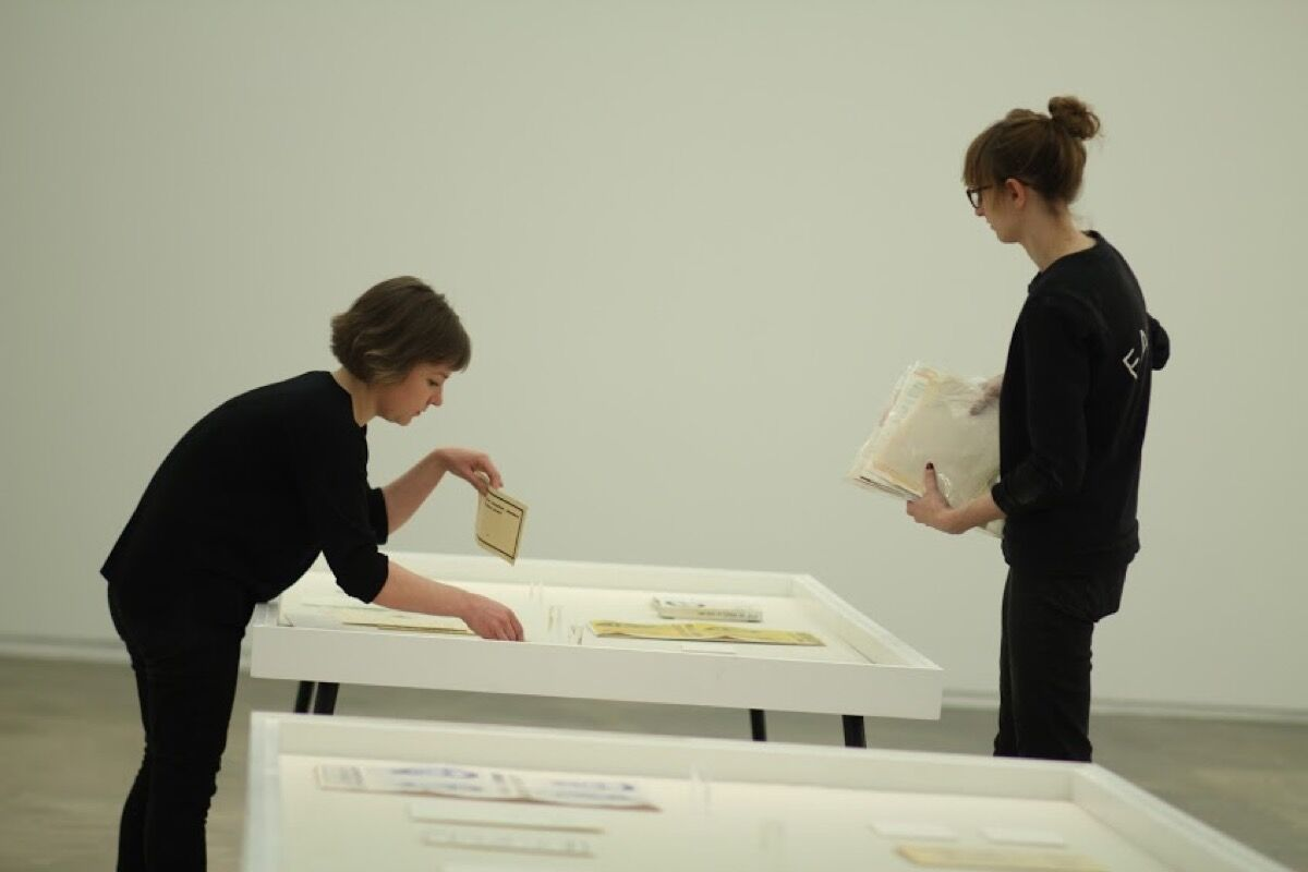 """Hunter MA Art History students Annie Wischmeyer and Jenn Bratovich installing """"Buren, Mosset, Parmentier, Toroni"""" at Hunter's 205 Hudson Gallery. Courtesy of Hunter College, CUNY."""