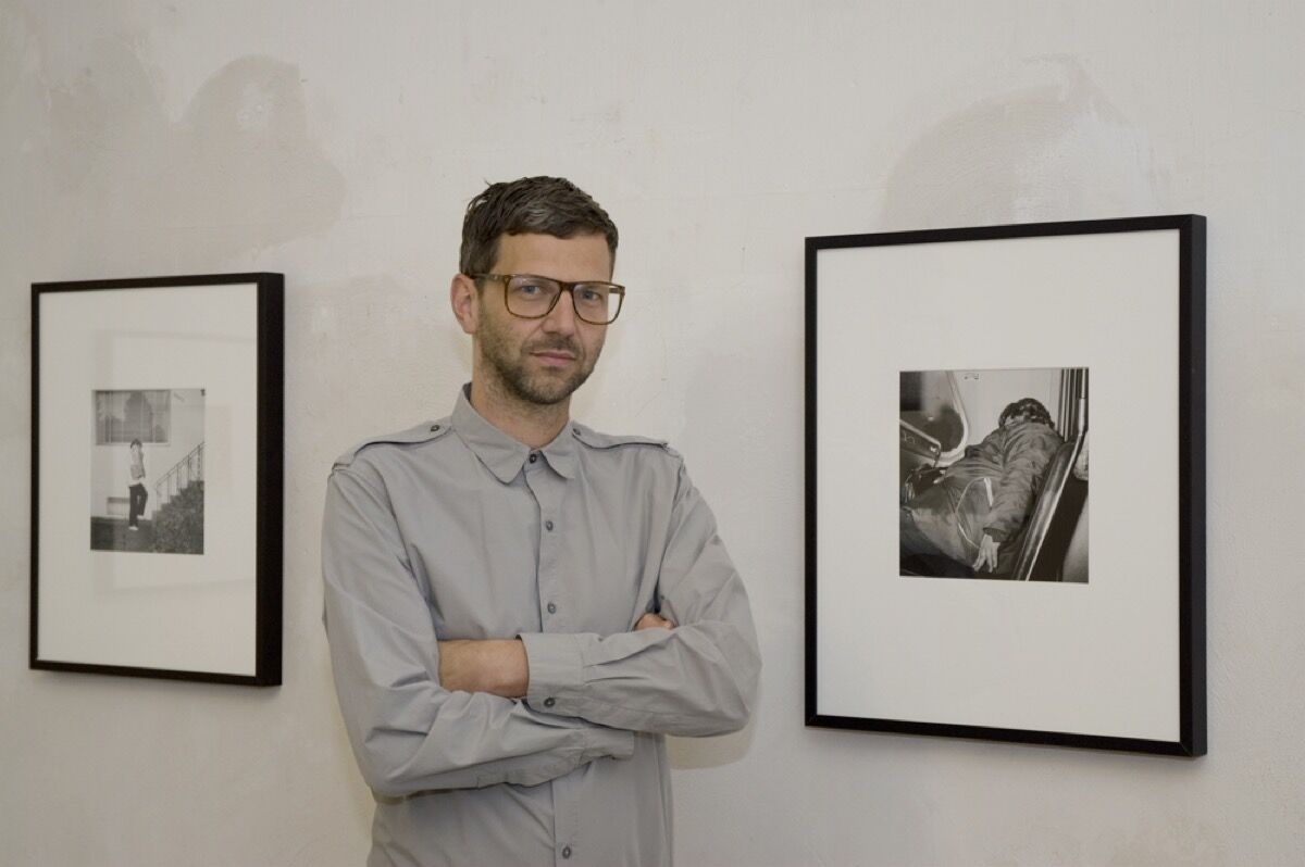 Christian Siekmeier of Exile with photographs by Bill Jacobson. Photo by Keith McEvoy, courtesy of Exile.