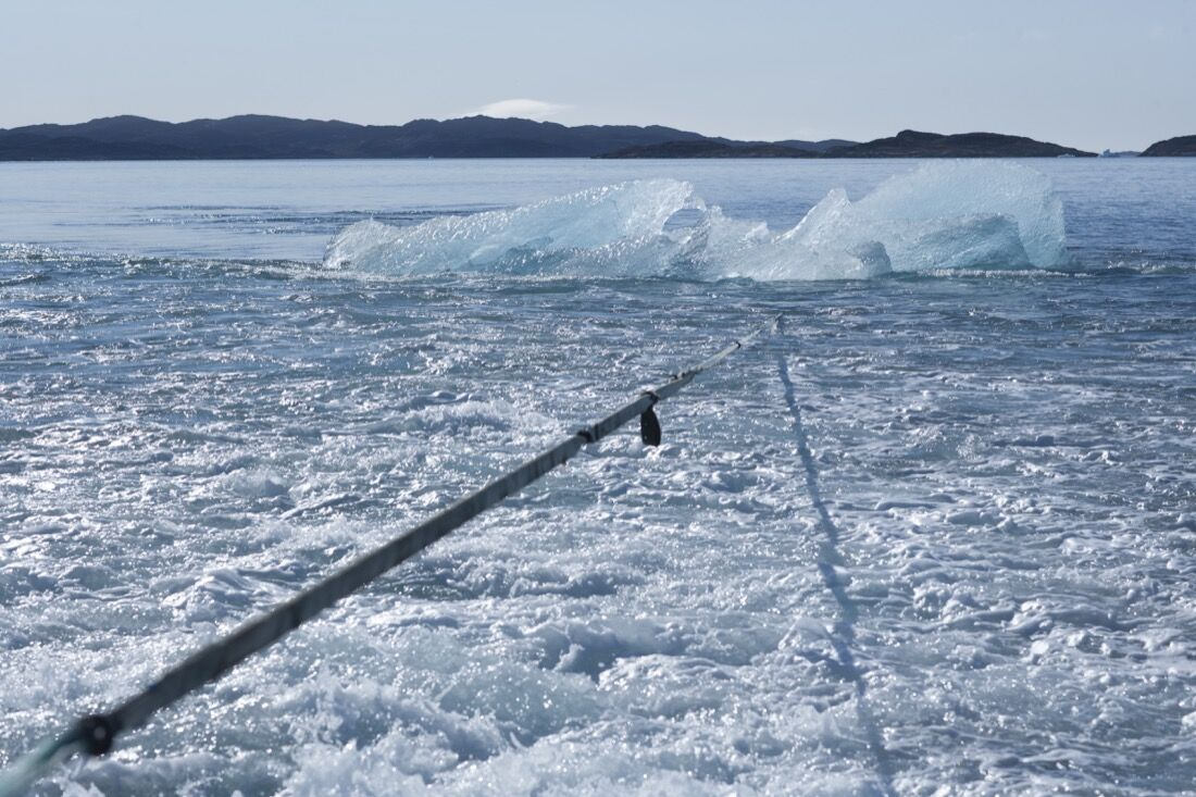 Towing the block of ice through Nuup Kangerlua, Greenland. Photo by Jørgen Chemnitz, courtesy of Olafur Eliasson.