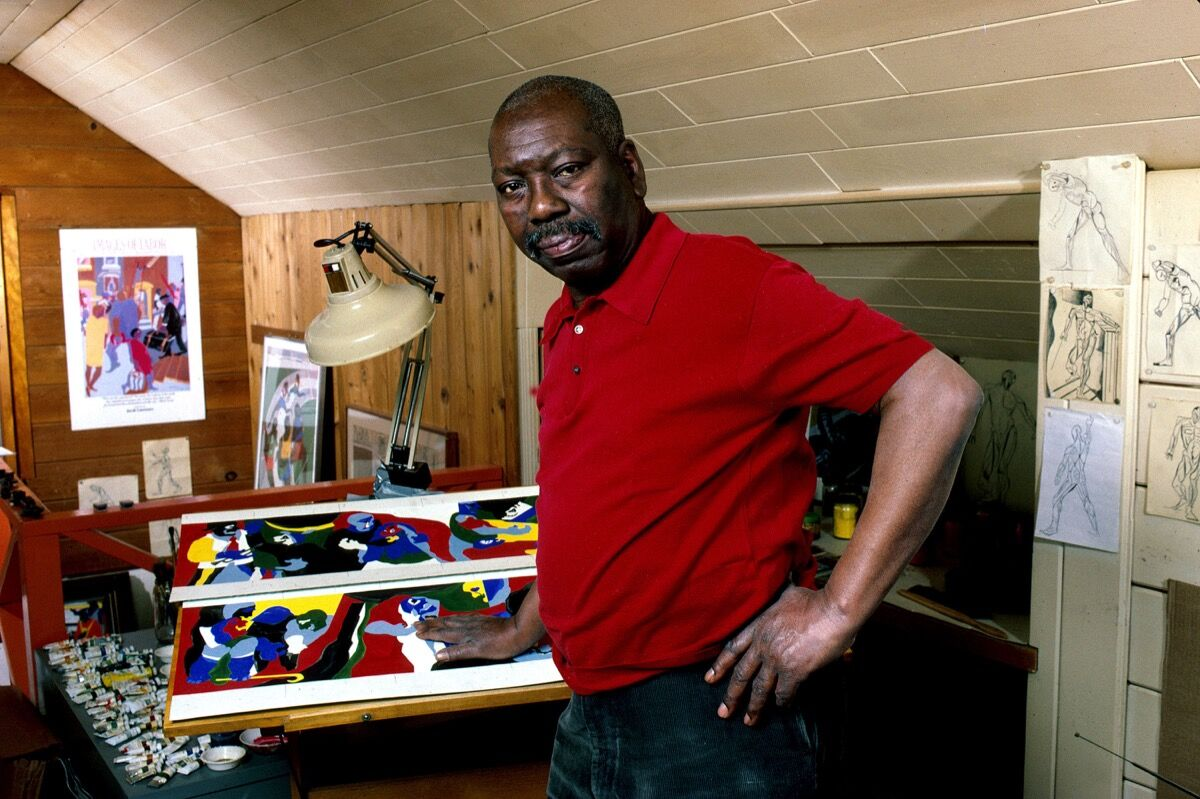 Painter Jacob Lawrence poses in his studio, Seattle, Washington, December 1, 1989. Photo by George Rose/Getty Images.