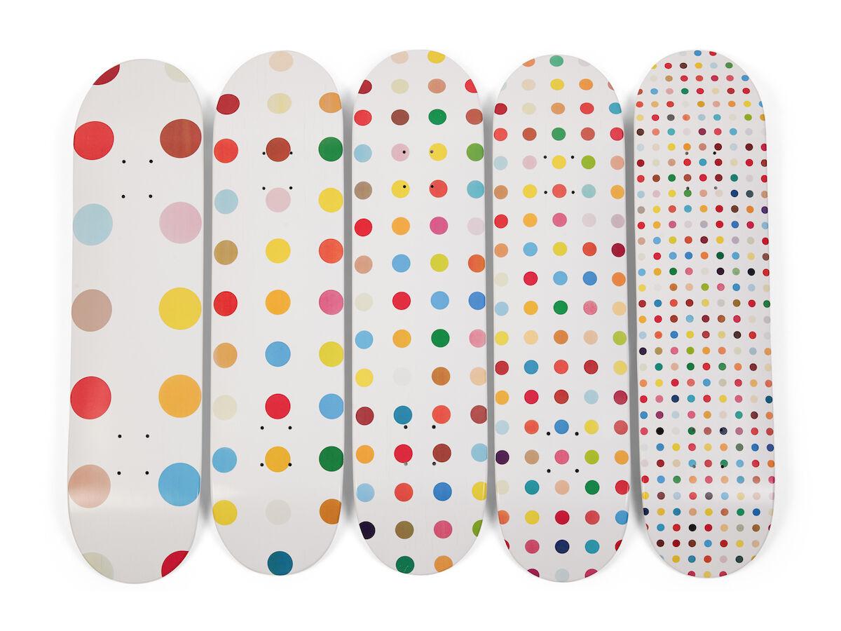 Supreme skateboard decks customized by Damien Hirst. Courtesy Sotheby's