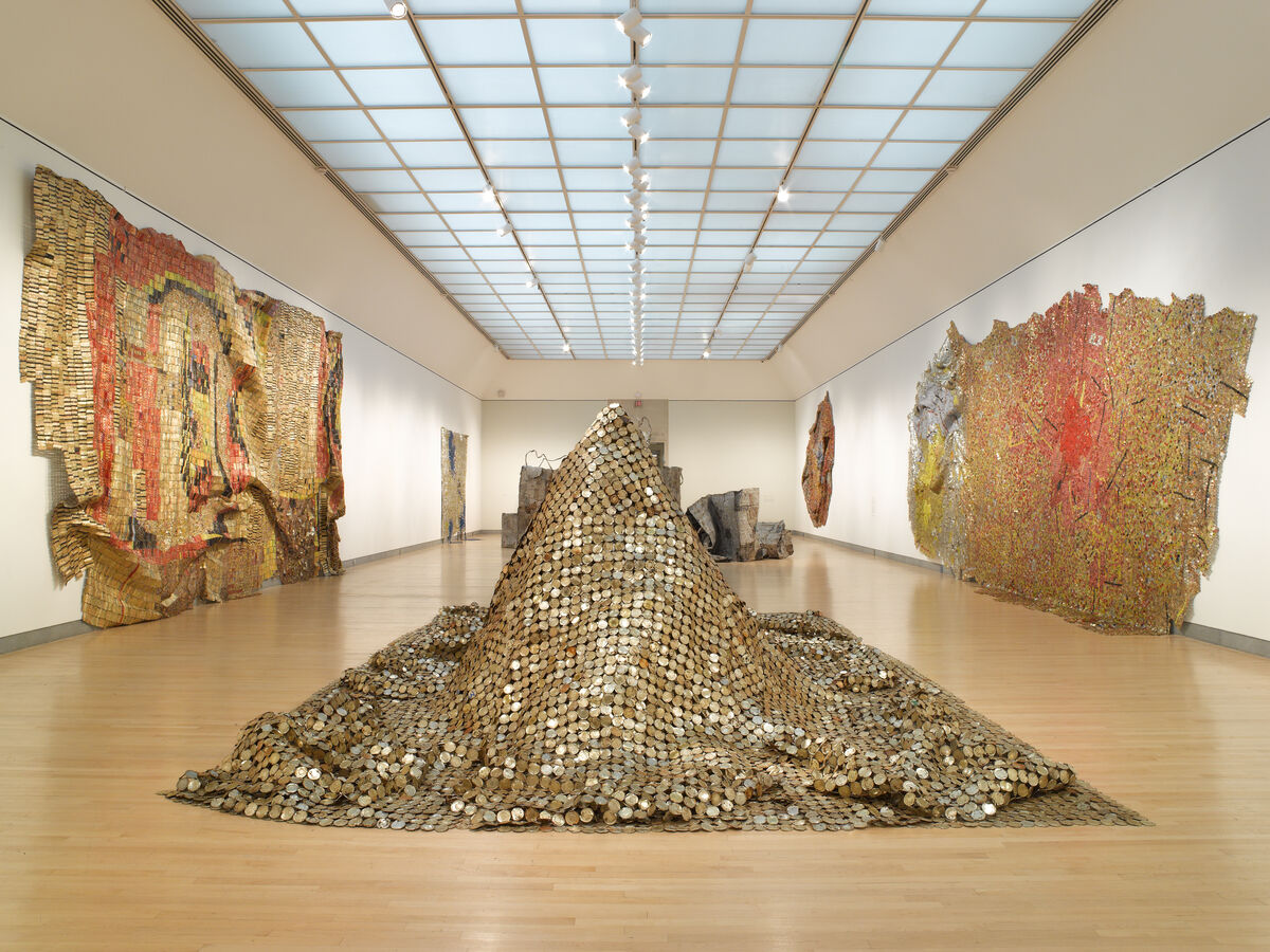 "Installation view of ""Gravity and Grace: Monumental Works by El Anatsui"" at the Brooklyn Museum, 2013. Courtesy of the Brooklyn Museum."