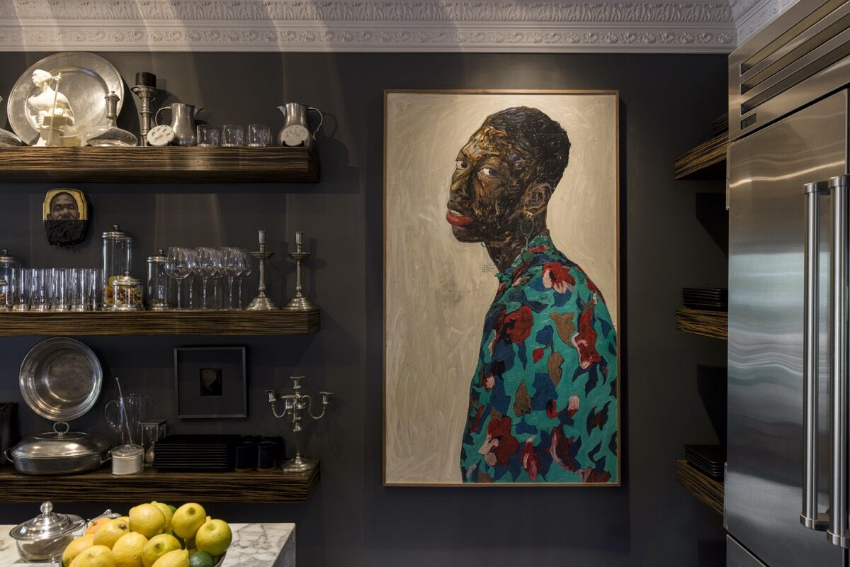 Installation view of Arthur Lewis's collection, featuring Amoako Boafo, Boy with Flower Earring, 2019. Photo by Jeff McLane. Artwork courtesy of the artist and Roberts Projects, Los Angeles. Photo courtesy of Arthur Lewis.