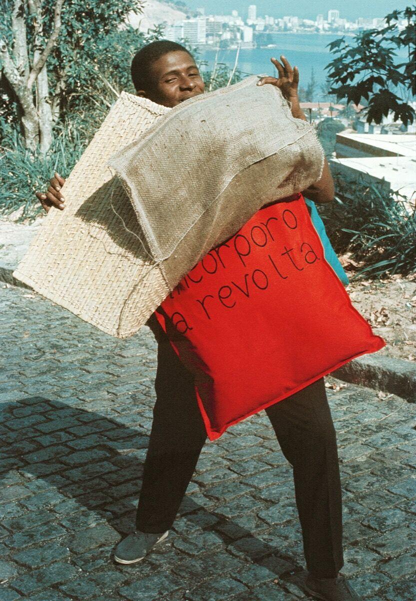 Hélio Oiticica, P15 Parangolé Cape 11, I Embody Revolt, worn by Nildo of Mangueira, 1967. Courtesy of César and Claudio Oiticica. Photo by Claudio Oiticica.