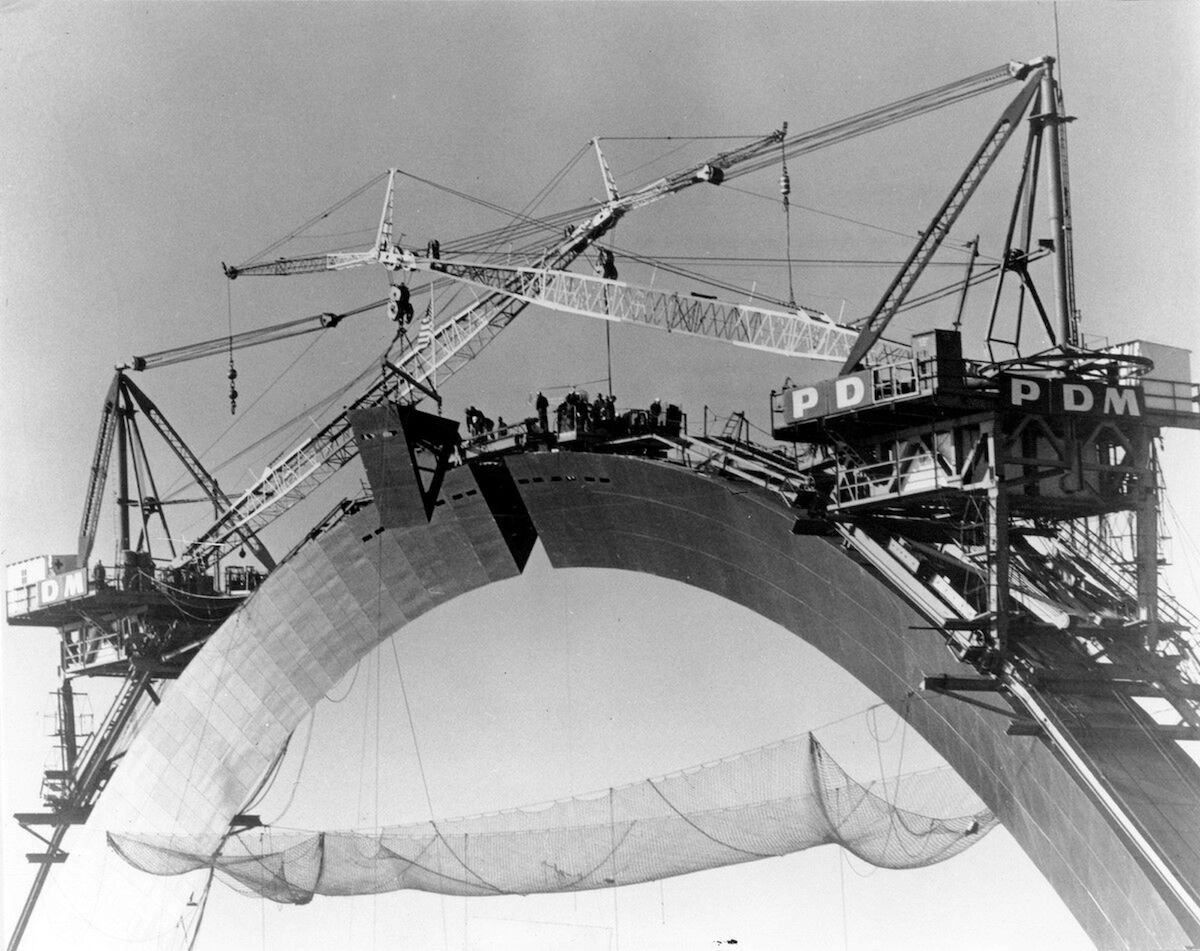 Photo of the Arch during construction, just prior the closure and placement of the final section in October 1965. Photo courtesy of the National Park Service JNEM Archives.