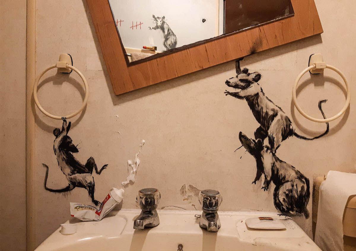 Murals in Banksy's bathroom during self isolation. Image via banksy.co.uk.
