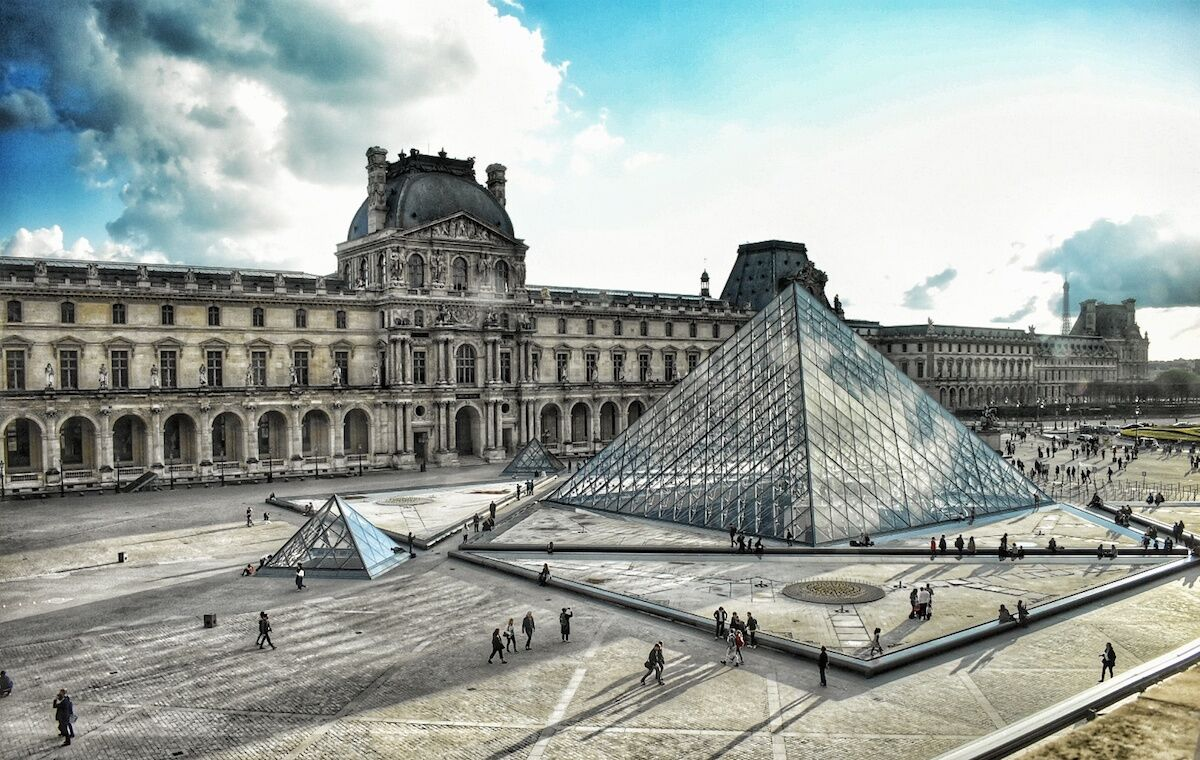 The glass pyramid at the Louvre, designed by I.M. Pei. Photo by Babyaimeesmom, via Wikimedia Commons.