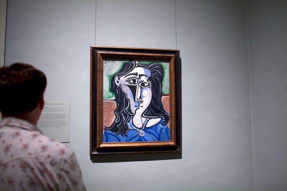A visitor at the Metropolitan Museum looks at a work by Pablo Picasso. Photo by Mister_Jack, via Flickr.