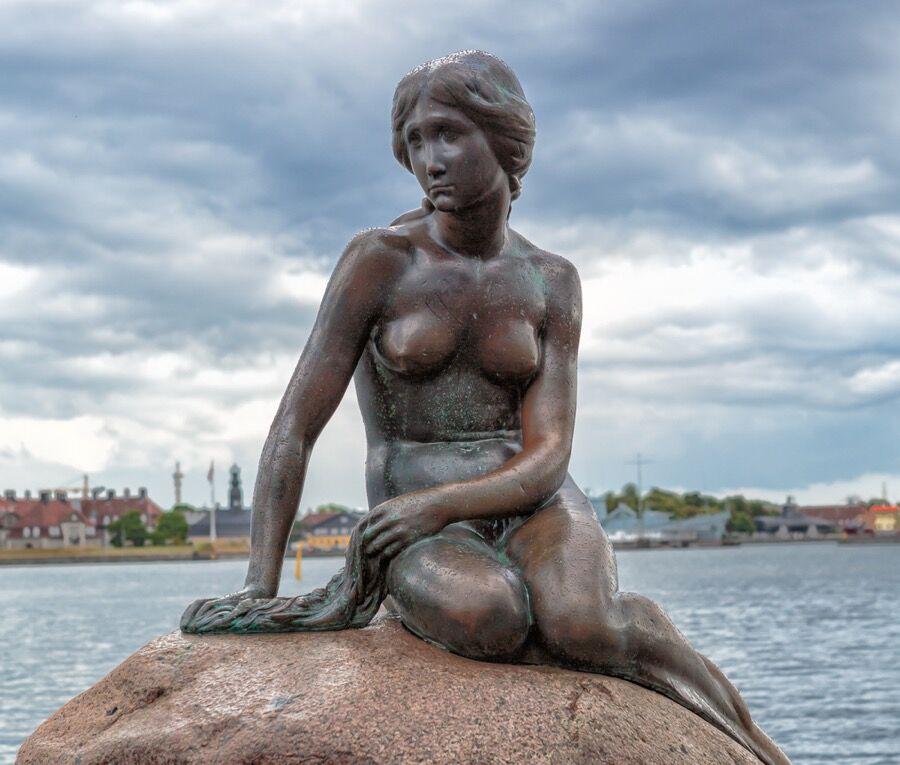 "The Little Mermaidbronze statue by Edvard Eriksen. Photograph:""Copenhagen—The Little Mermaid Statue—2013""by Avda-berlin."