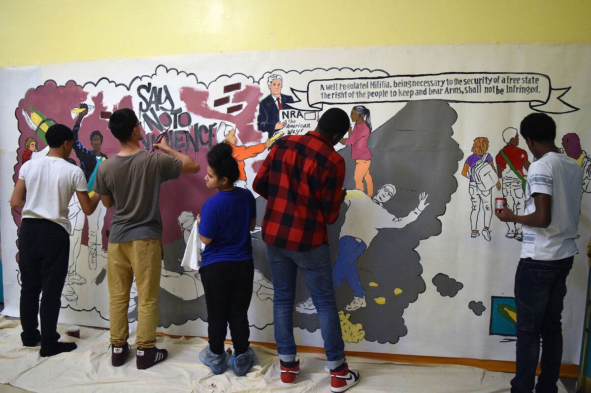 Students from School of Excellence High School working on their anti-gun violence mural project. Courtesy of The Bronx Museum of the Arts.