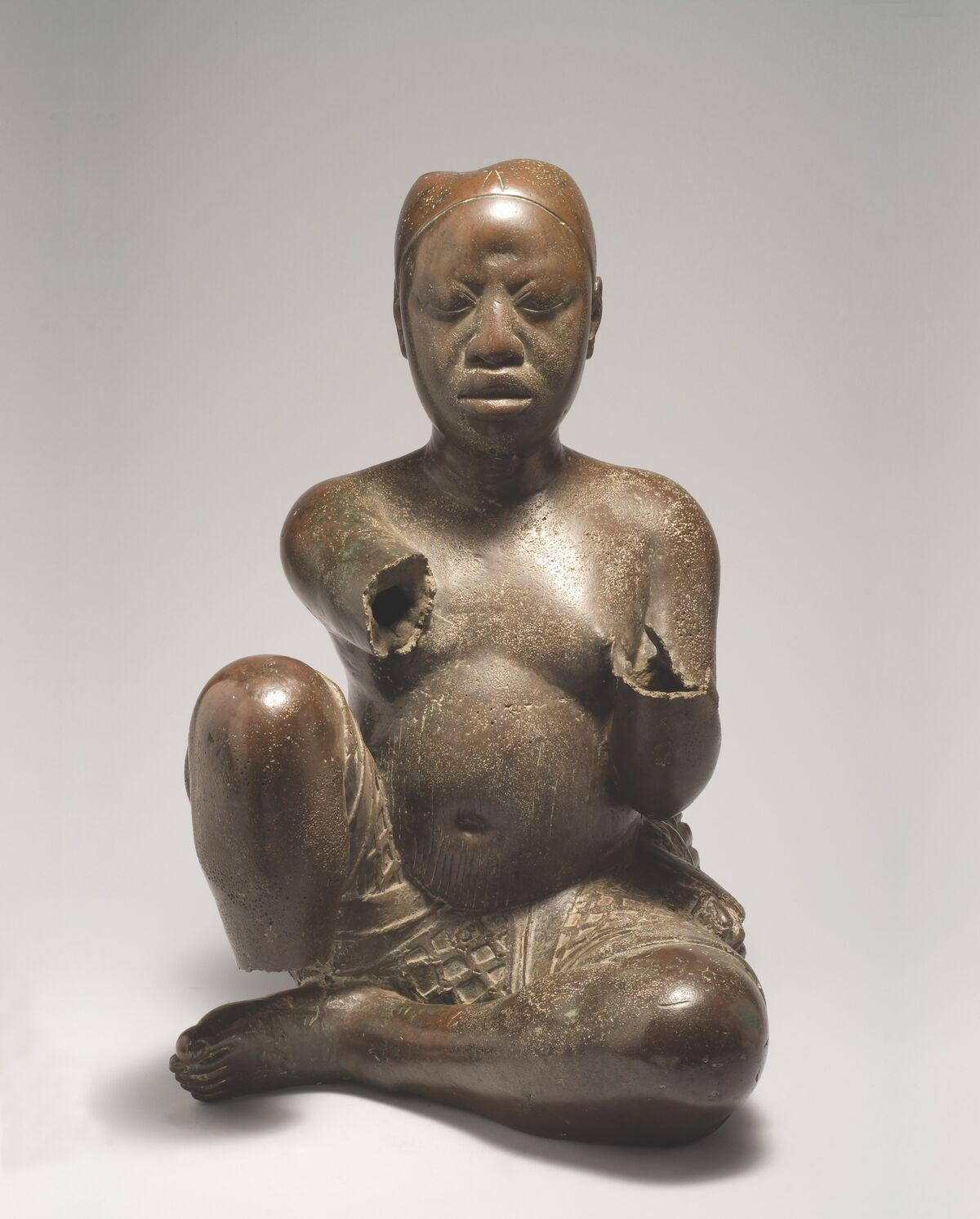 Seated Figure, Possibily Ife, Tada Nigeria, Late 13th–14th century. Courtesy of the National Commission for Museums and Monuments and the Block Museum.