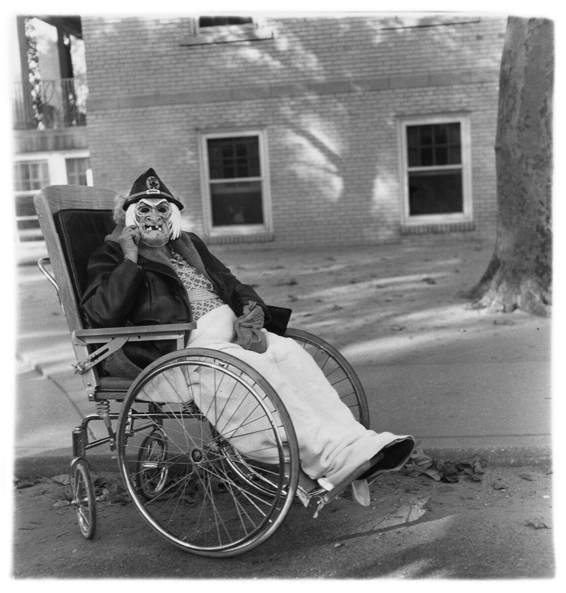 Diane Arbus, Masked woman in a wheelchair, Pa. , 1970. © The Estate of Diane Arbus.