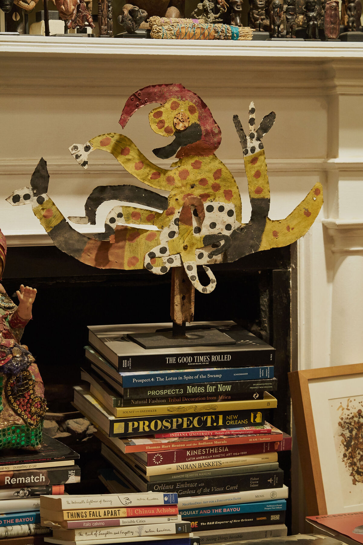 A sculpture by David Butler sits on top of a stack of books in William Fagaly's living room. In 1976, Fagaly curated the first exhibition of Butler's work at NOMA. Photo by Michael Adno for Artsy.