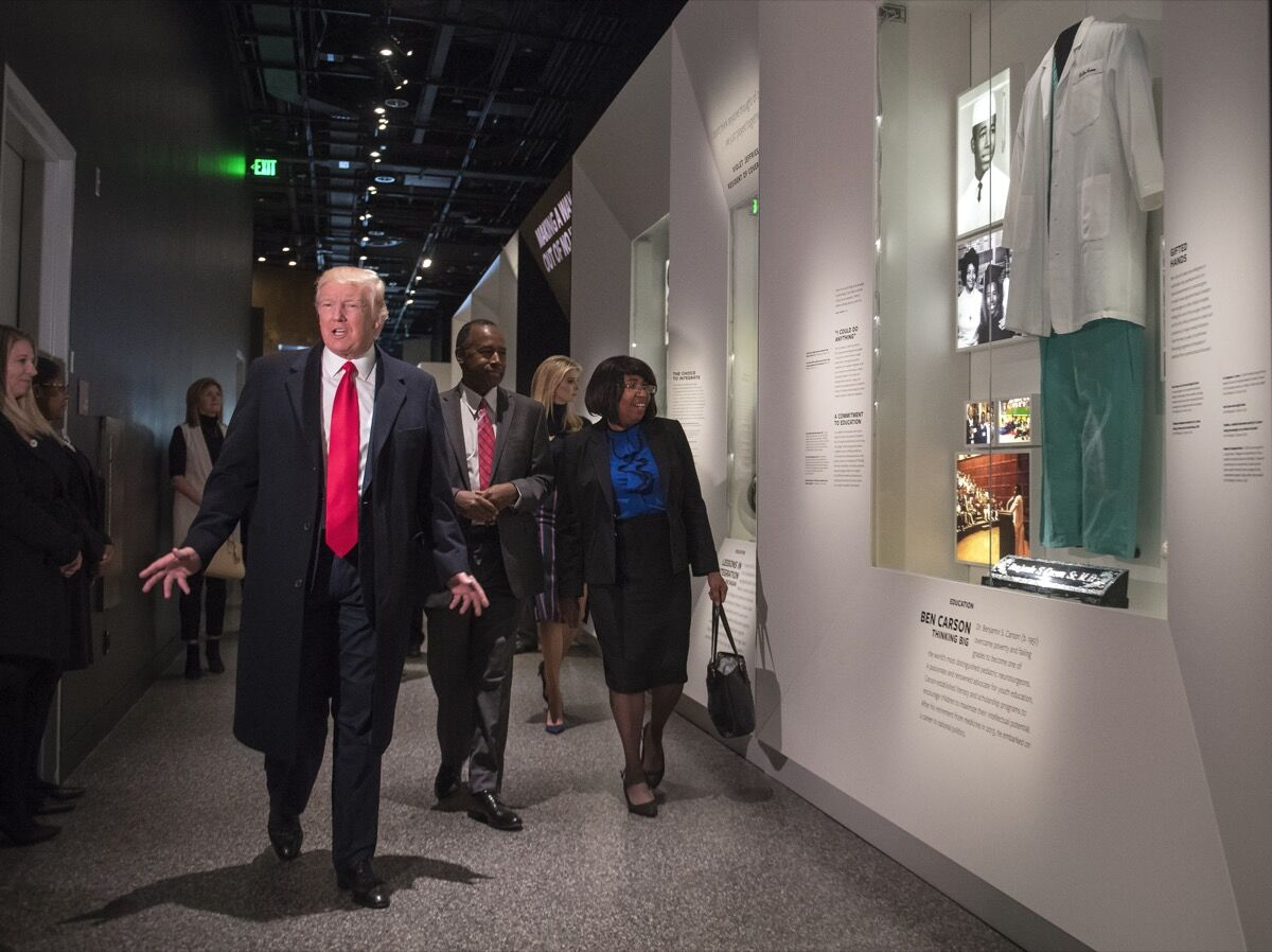 WASHINGTON, DC - FEBRUARY 21: (AFP OUT) President Donald Trump, joined by Dr. Ben Carson and his wife Candy, visit the Ben Carson exhibit as they tour the Smithsonian National Museum of African American History & Culture on February 21, 2017 in Washington, DC. (Photo by Kevin Dietsch - Pool/Getty Images)