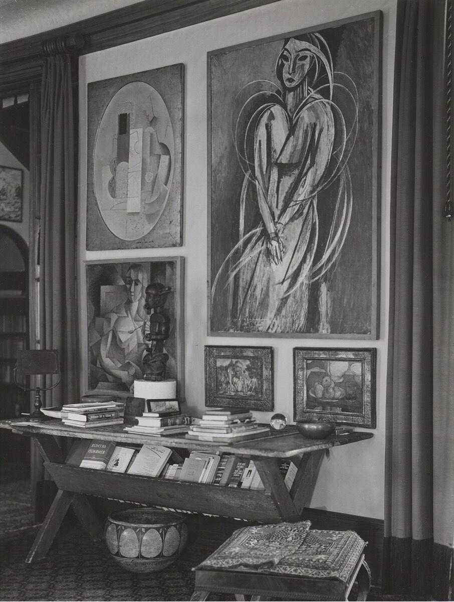 Detail of the living room of Louise and Walter Arensberg's house, 7065 Hillside Avenue, Los Angeles, October 1939. Photo © 2020 Museum of Fine Arts, Boston. Photo by Charles Sheeler. Courtesy of Museum of Fine Arts Boston, Lane Collection. Pictured artworks: Henri Matisse, Madame Yvonne Landsberg, 1914. © 2020 Succession H. Matisse / Artists Rights Society (ARS), New York; Picasso, Still Life with a Violin and a Guitar, 1912–13. © 2020 Estate of Pablo Picasso / Artists Rights Society (ARS), New York.