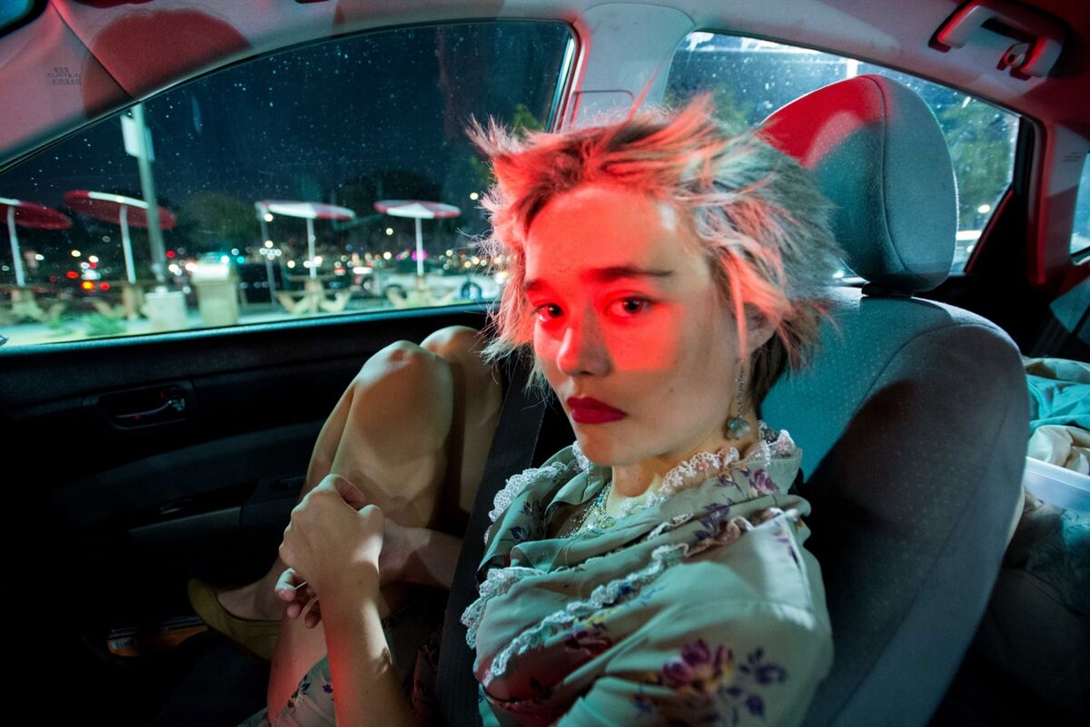 """Kat, 16, in a drive-thru on Halloween night. """"She checked her phone and started to cry but wouldn't tell me why,"""" Bottoms said. """"All I could do was sit there and comfort her. I asked if I could take her photo. She said yes and looked right at me. Sometimes her resistance to communicate is hard."""" From Bottoms's ongoing story about the relationship between her mother and Kat, who has autism and prodromal schizophrenia. Photo by September Dawn Bottoms. Courtesy of the artist."""
