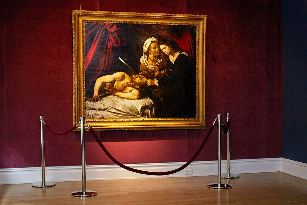 Installation view of Caravaggio, Judith and Holofernes,  ca. 1607.  Photo by Eva Sakellarides. Courtesy of Eric Turquin.