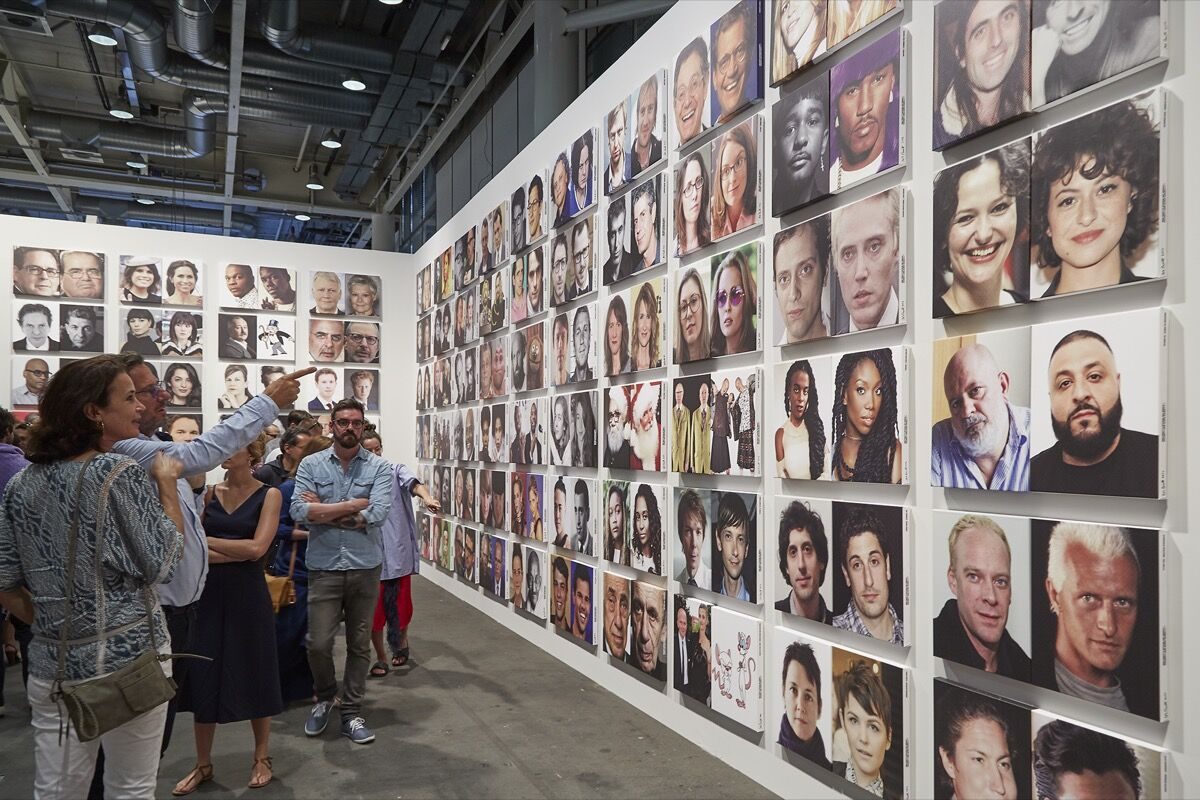 Installation view of Rob Pruitt, Rob Pruitt's Official Art World / Celebrity Look-Alikes, 2016/2017, presented by Gavin Brown's enterprise at Art Basel Unlimited, 2017. Photo by Benjamin Westoby for Artsy.