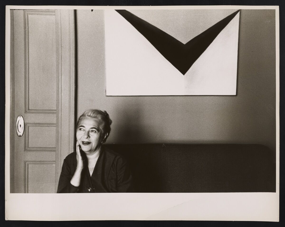 Edith Halpert in 1955 with Georgia O'Keeffe's In the Patio IX, one of the prizes of her personal collection. Courtesy of the Jewish Museum.