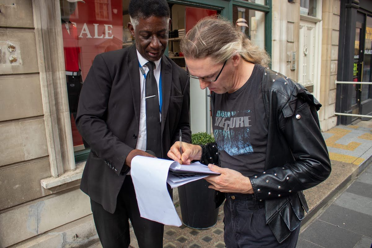 A visitor to the ArtShop signs a document confirming he is not there on behalf of Anish Kapoor. Photo courtesy ArtShop.