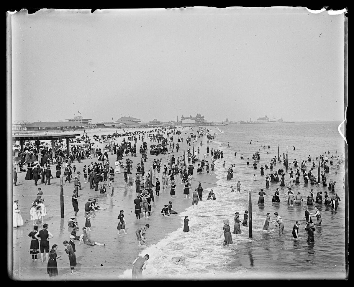 Robert Blacklow, Beachgoersat Coney Island, Brooklyn, New York City, August 6, 1898. Photo via the Metropolitan New York Library Council.
