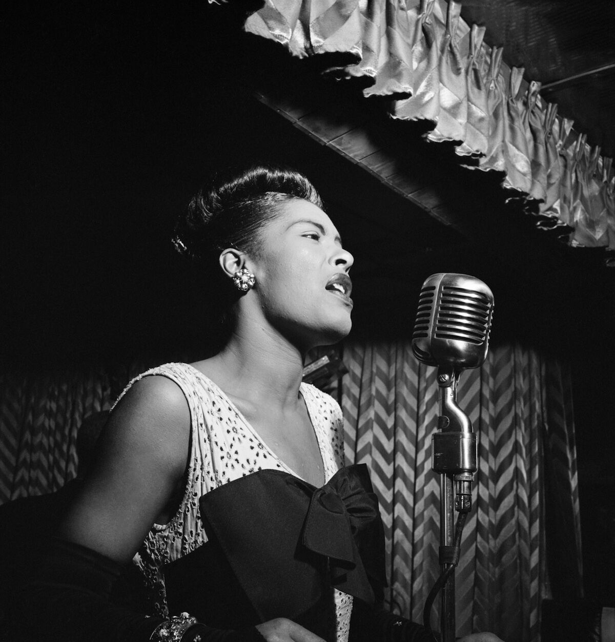 Billie Holiday performing in New York City circa 1947. Photo by William P. Gottlieb, courtesy the Library of Congress, via Wikimedia Commons.