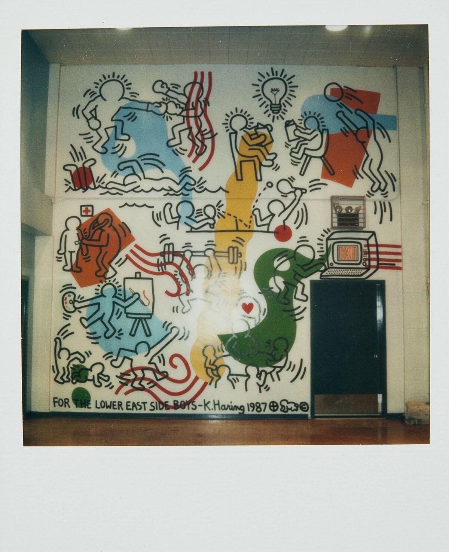 Polaroid of Keith Haring's Boy's Club Mural, Pitt Street, New York City, 1987. © Keith Haring Foundation. Courtesy of The Keith Haring Foundation Archives.
