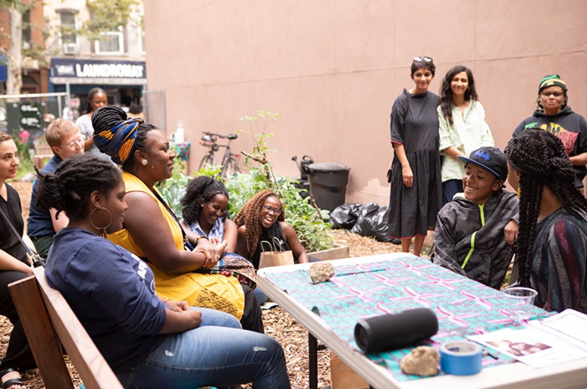 Community members gather at Feeding Tree Community Garden in Bed-Stuy during 2019 Create Change Artist-in-Residence Bianca Mońa's project, Wholeness Manifested. Photo by Neha Gautam. Courtesy of The Laundromat Project.