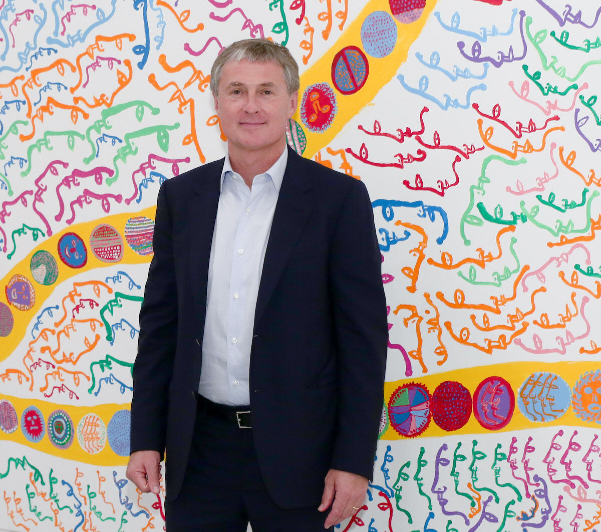 """David Zwirner at Yayoi Kusama's 2013 """"I Who Have Arrived In Heaven"""" Exhibition. Photo by Andrew Toth via Getty Images."""