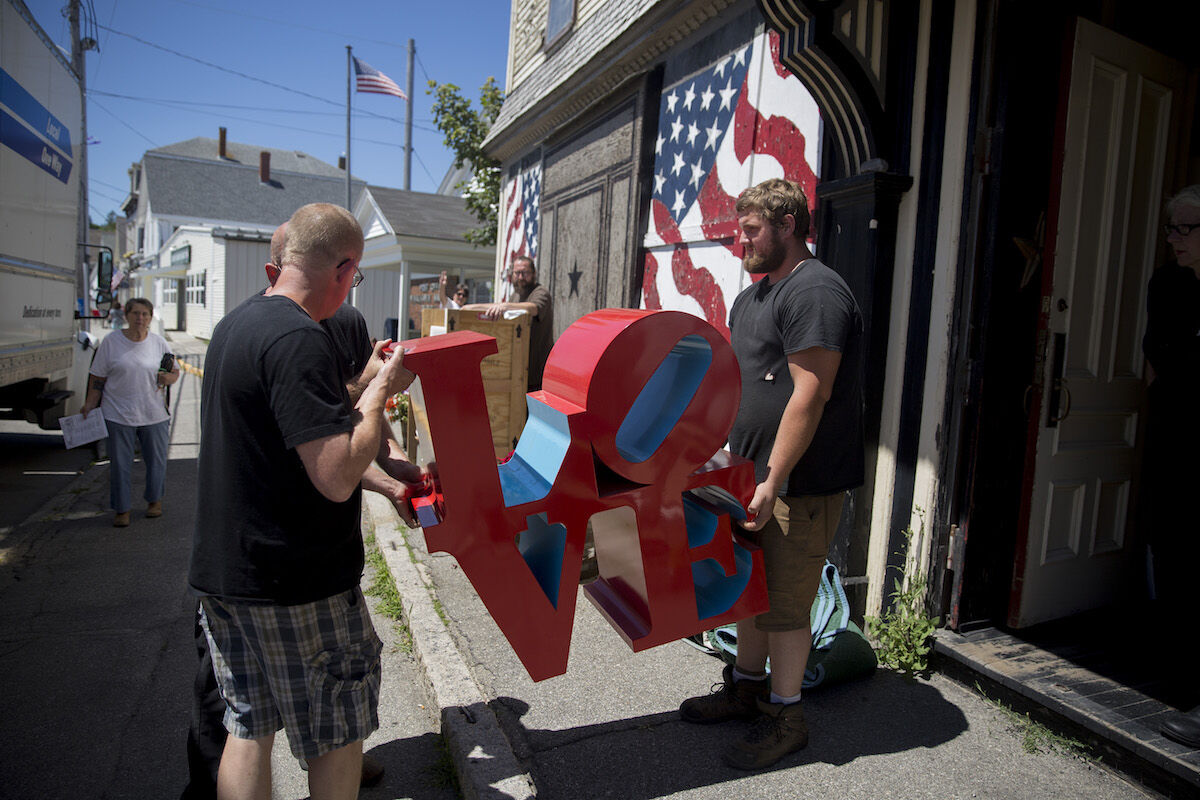 "A ""LOVE"" sculpture being removed from Robert Indiana's home in the summer of 2018. Staff photo by Brianna Soukup/Portland Press Herald via Getty Images."