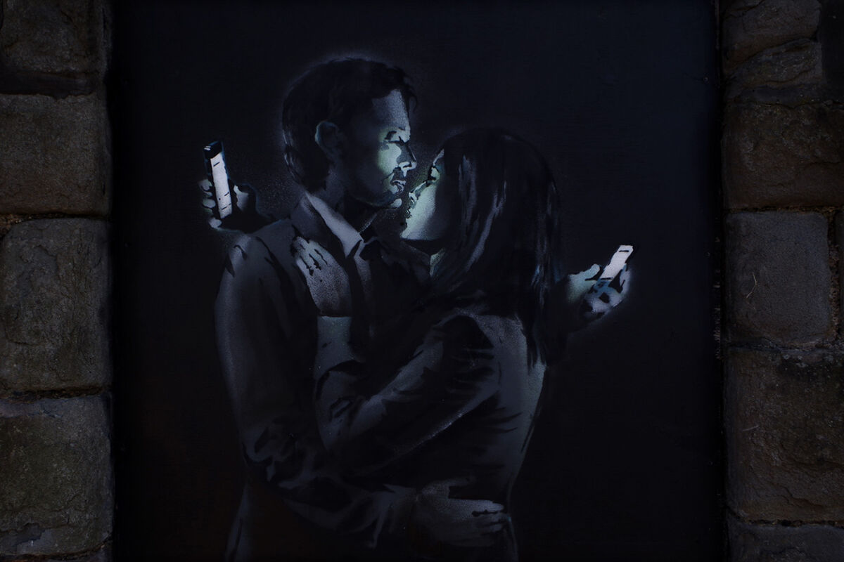 Banksy, Mobile Lovers, 2014. Photo by Duncan Hull, via Flickr.
